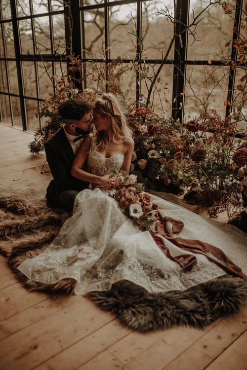 Bride in strapless wedding dress and groom in tuxedo for Christmas wedding inspiration
