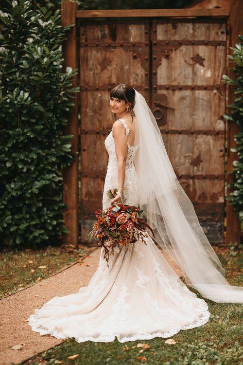 Bride in Abbie Maggie Sottero wedding dress