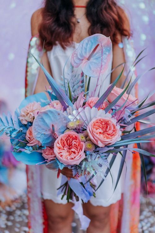 pastel wedding bouquet with spray painted anthuriums and grasses