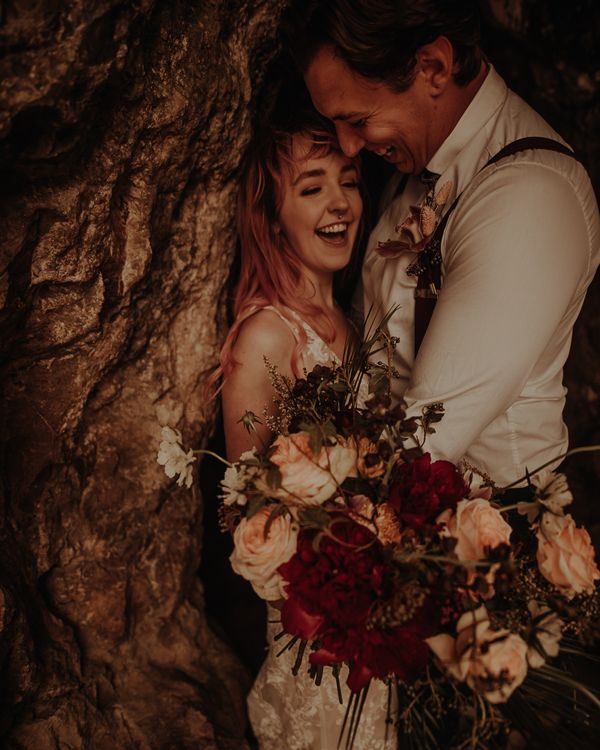 Bride and groom laughing at beach cove wedding photography