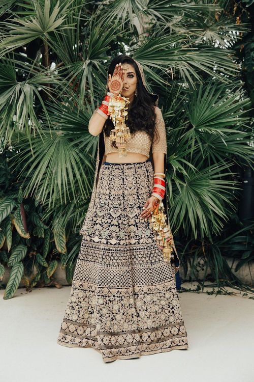 Bride in Hindu wedding outfit with henna