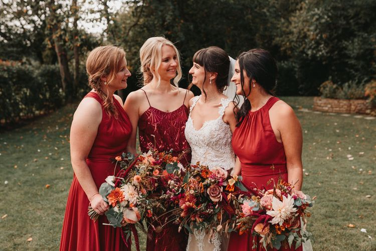 Bridal party portrait with bridesmaids in rust dresses at Millbridge Court wedding