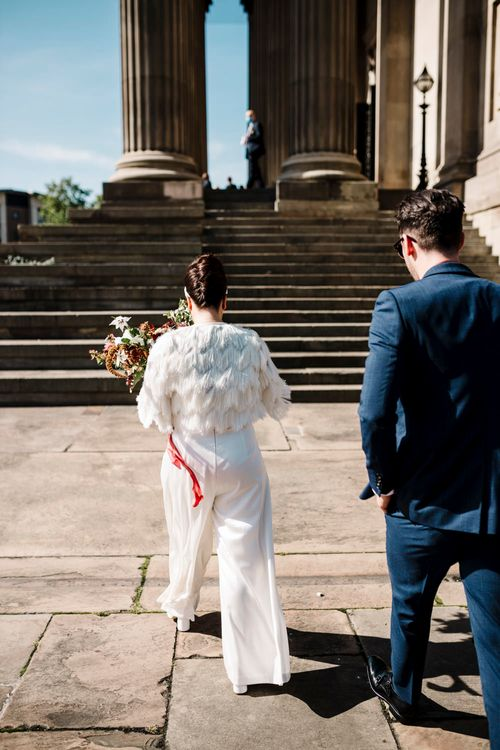 Bride in Faux fur coverup and trousers