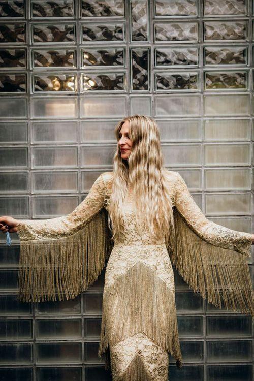 Bride in gold fringe wedding dress