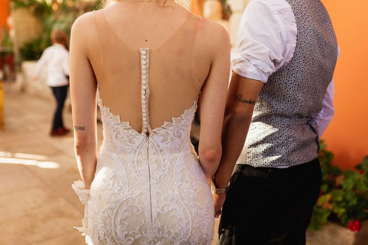 Bride in illusion back Wona Concept wedding dress with buttons