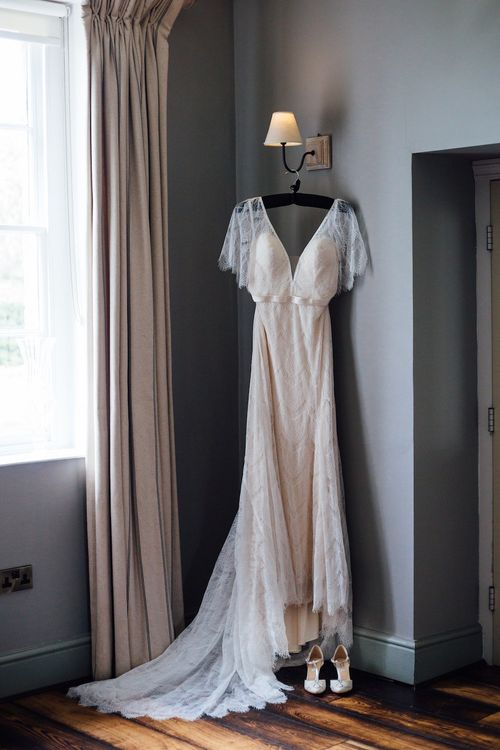 Wedding dress hung in bedroom on the morning of the wedding