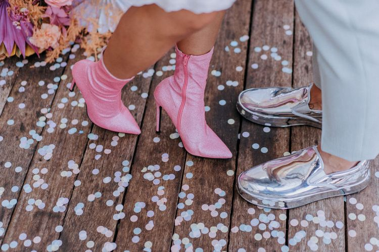 Pink bridal boots and shiny silver trainers