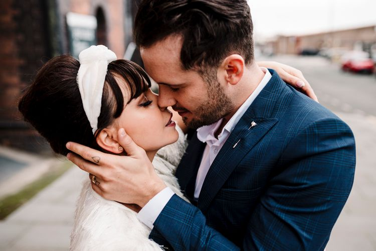 Intimate portrait of bride and groom kissing