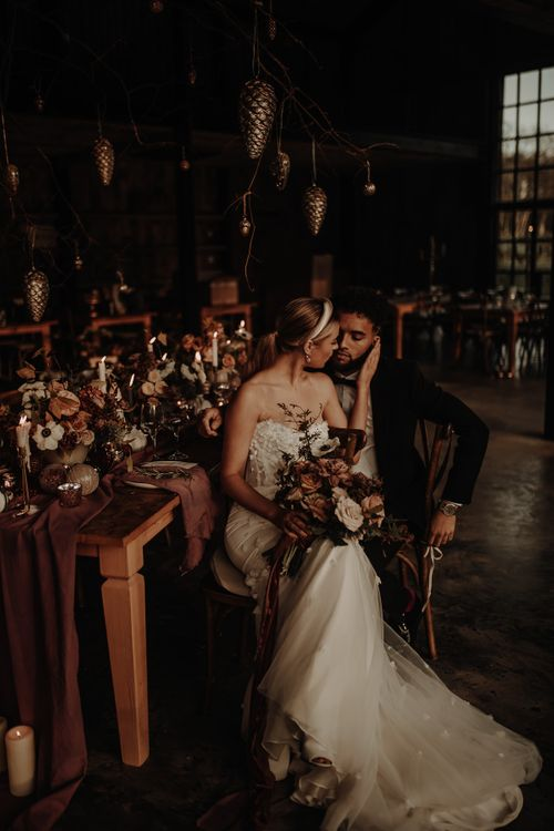 Bride and groom sitting at their intimate winter wedding table