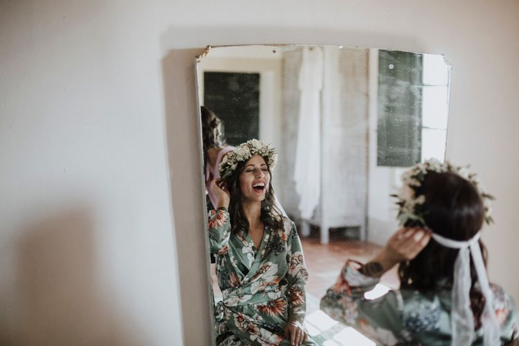 Bride getting her hair done on the morning of the wedding