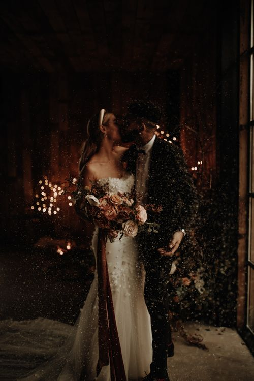Bride and groom at Christmas wedding inspiration shoot with snowfetti