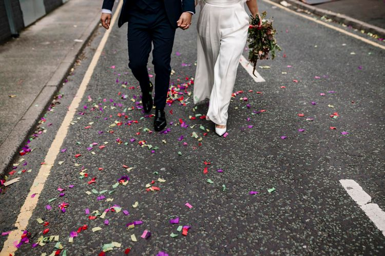 Confetti covered floor at city wedding
