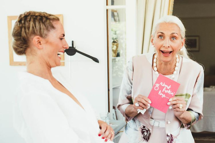 Bride laughing at her mum on the morning of her wedding