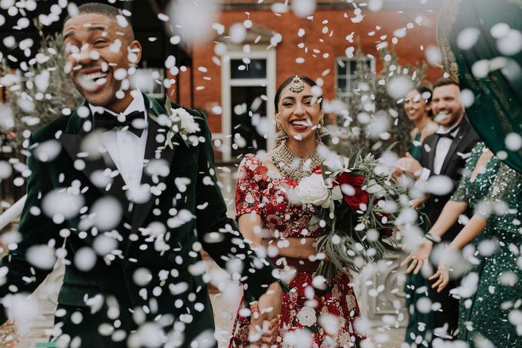 White confetti shot at Caribbean and Indian multicultural wedding