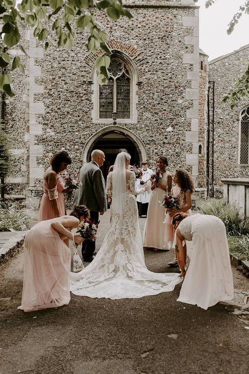 Bride arriving at church in lace dress