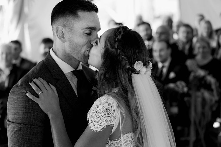 First kiss after wedding ceremony