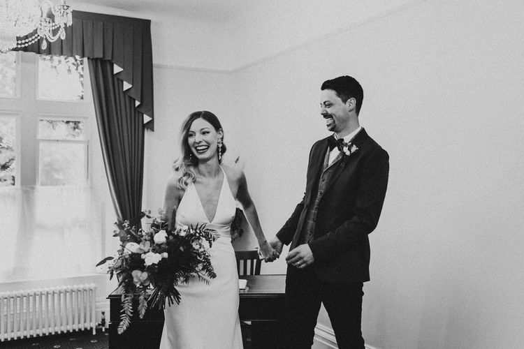 Black and white portrait of bride and groom just married