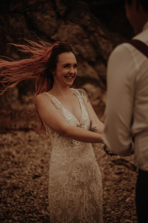 Bride in lace wedding dress at intimate elopement
