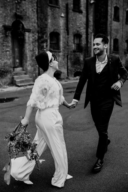 Stylish city wedding with bride in trousers and turban headband