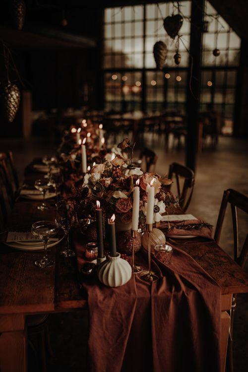 Flower and candle table centrepiece for Christmas wedding inspiration