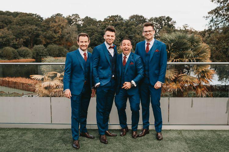 Groomsmen in navy suits at Millbridge Court autumn wedding