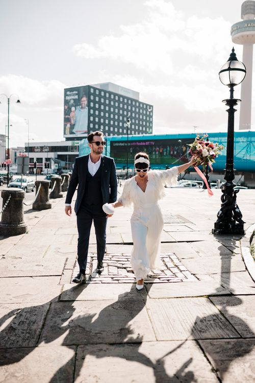 Bride and groom walking through Liverpool at micro wedding