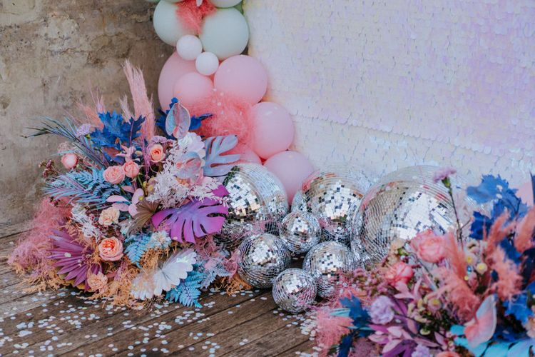 Disco balls and balloons at holographic pastel wedding inspiration