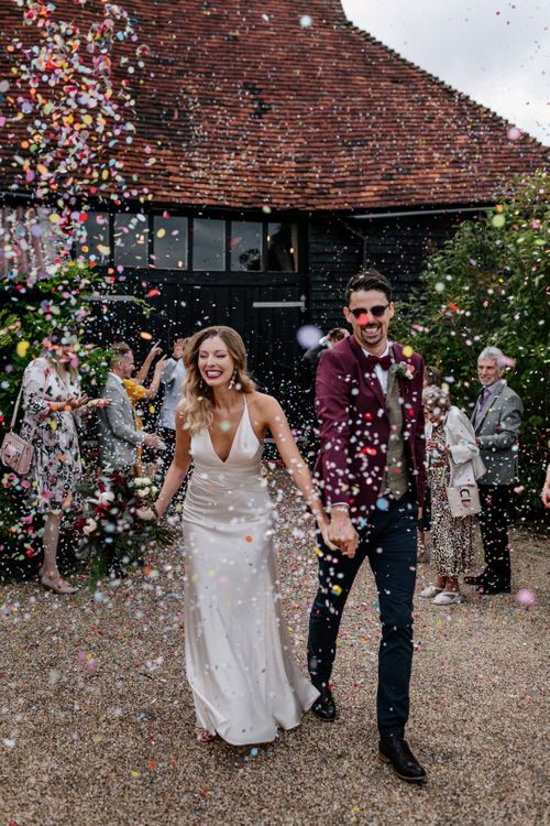 Confetti moment at High Billinghurst Farm by Epic Love Story