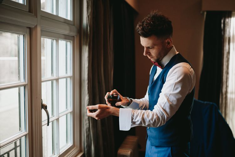 Groom getting ready on the morning of the wedding