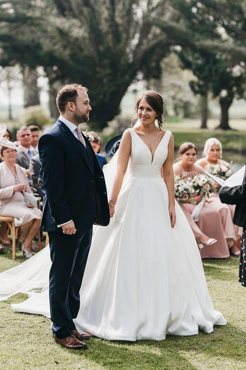 Stella York wedding dress with plunge neckline