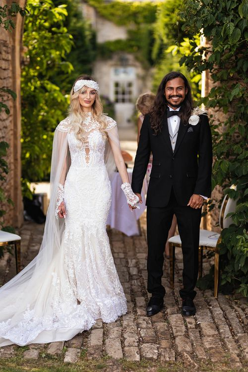 Stylish bride in lace Wona Concept wedding dress and groom in black suit at Euridge Manor
