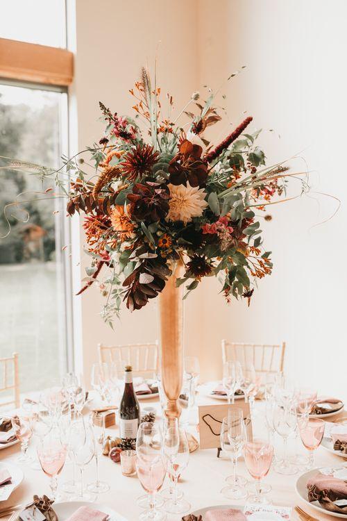 Tall autumn wedding flower centrepiece at Millbridge Court venue in Surrey