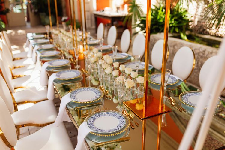 White and gold place settings at intimate Euridge Manor reception