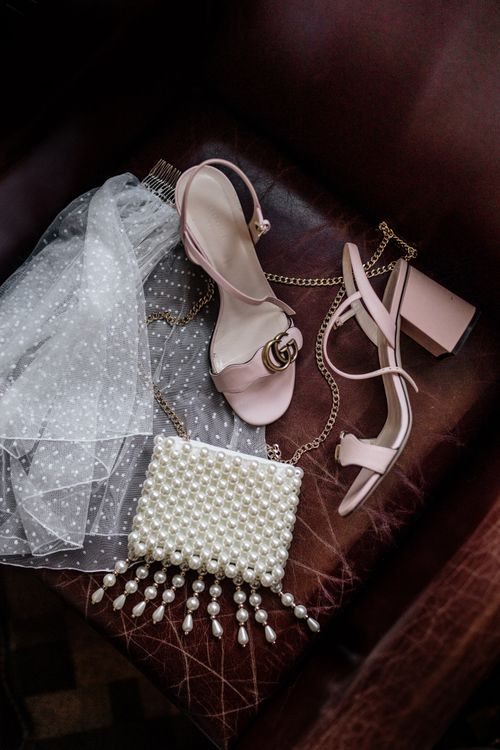 Gucci shoes, pearl handbag and polka dot veil bridal accessories