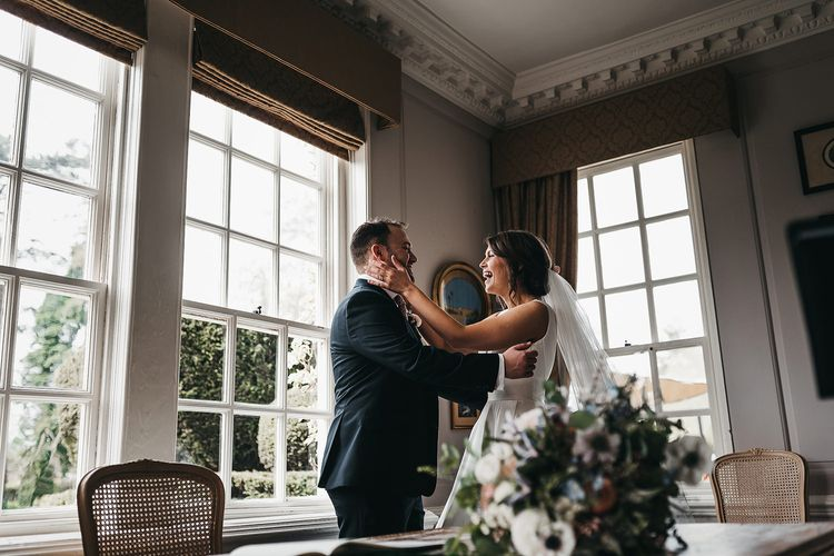Bride and groom steal a moment at Brinsop Court wedding
