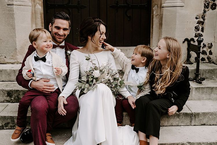 Family wedding portrait with bride groom and their children