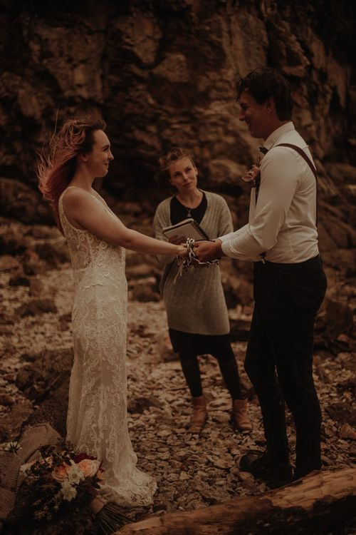 Bride and groom exchanging vows at intimate elopement