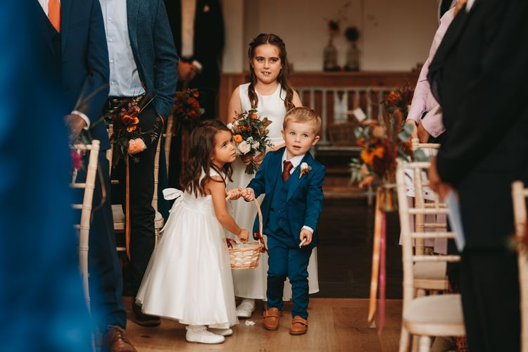 Flower girls and page boys laying petals at Millbridge Court wedding