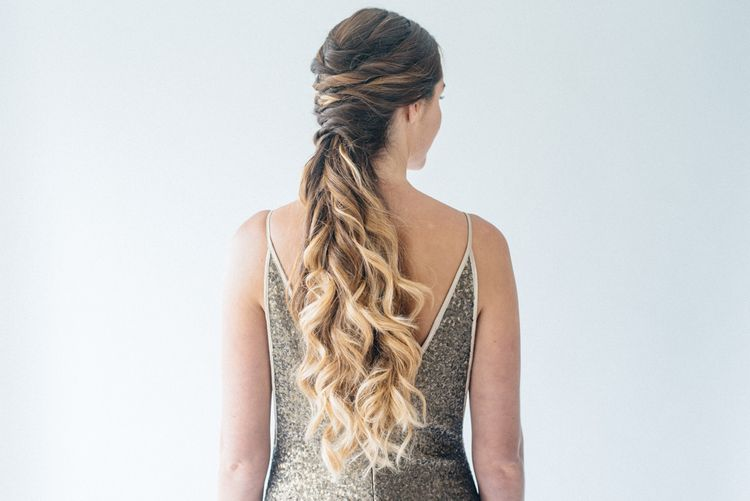 Twisted Pony Tail With Tousled Waves