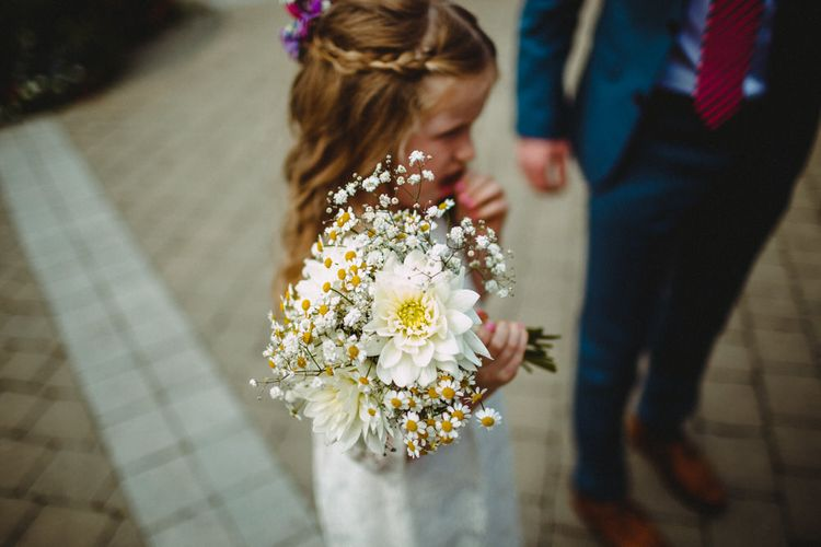Flower Girl In White Dress With White Posy