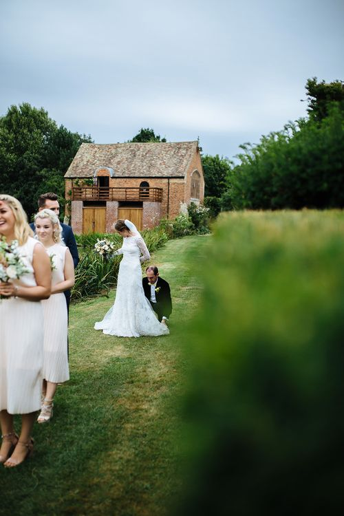 Outdoor Wedding Ceremony at Childerley Hall | Bride in Lace Sottero & Midgley Gown | Bridesmaids in & Other Stories Dresses | Tawny Photo