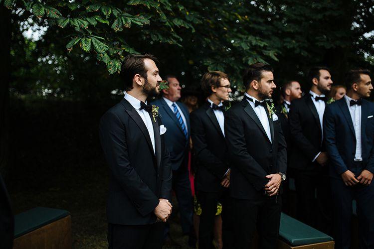 Groom in Herrvon Eden Tuxedo | Groomsmen in Marks and Spencer Suits | Tawny Photo