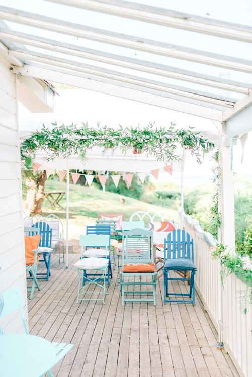 Veranda with Deck Chairs & Floral Garland