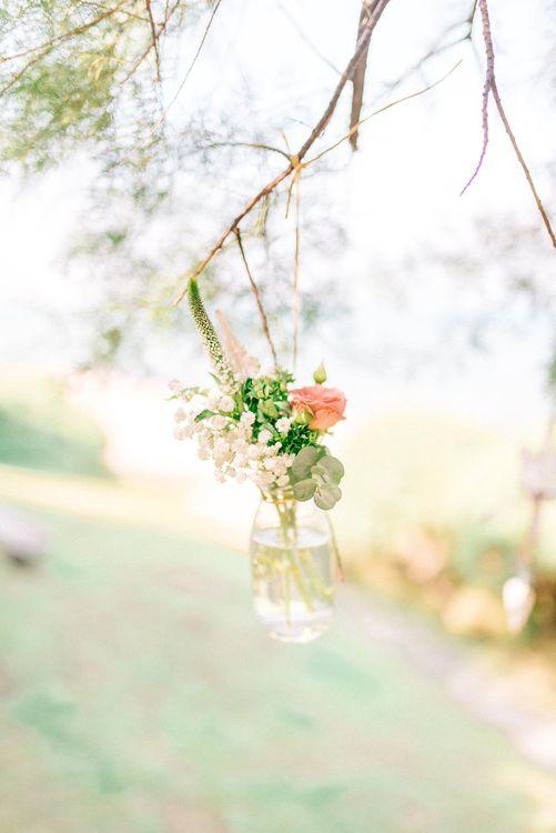 Hanging Flower Stems in Glass Bottles