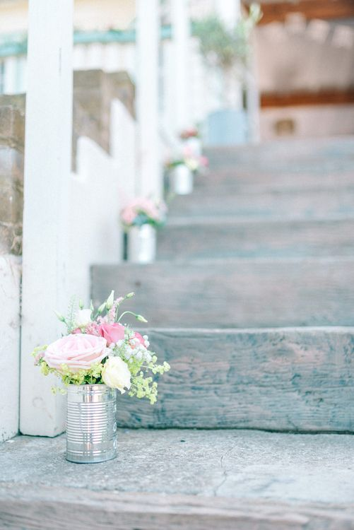 Wedding Flowers in Tin Cans Lining the Steps