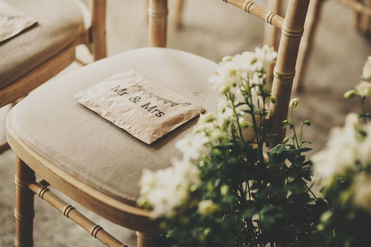 Brown Paper Confetti Bags on Ceremony Chairs