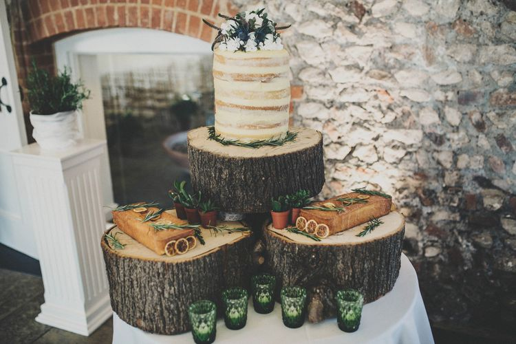 Rustic Cake Table with semi Naked Wedding Cake on Tree Stump Cake Stand