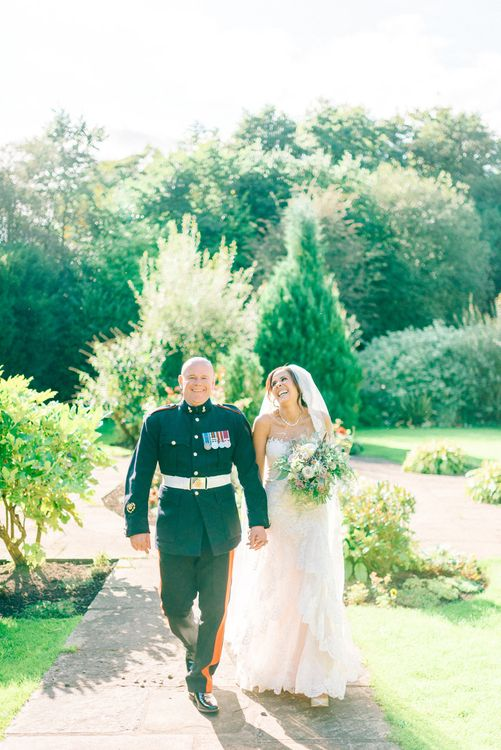 Bride in Lace Illusion Essense of Australia Wedding Dress & Groom in Military Dress