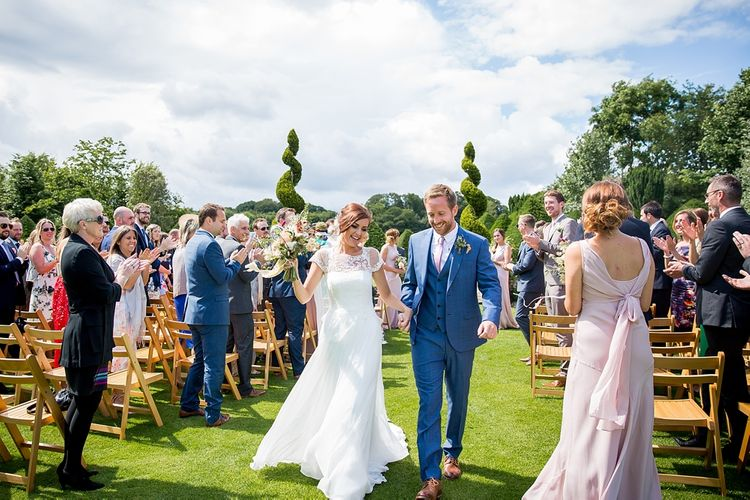 Outdoor Wedding Ceremony with Bride in Infanta Wedding Dress & Groom in Blue French Connection Suit