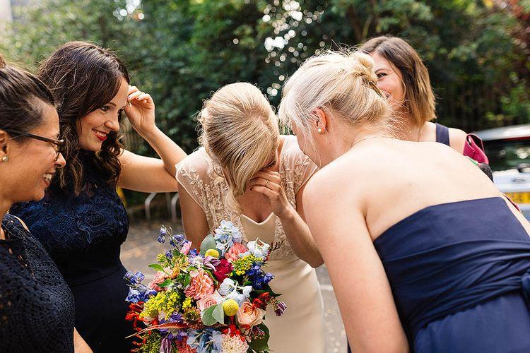 Bride in Catherine Deane Zaden Gown & Bright Bouquet